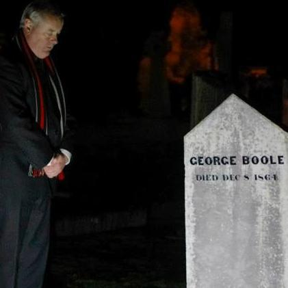 Michael Holland, University Curator paying respects at George Boole's grave