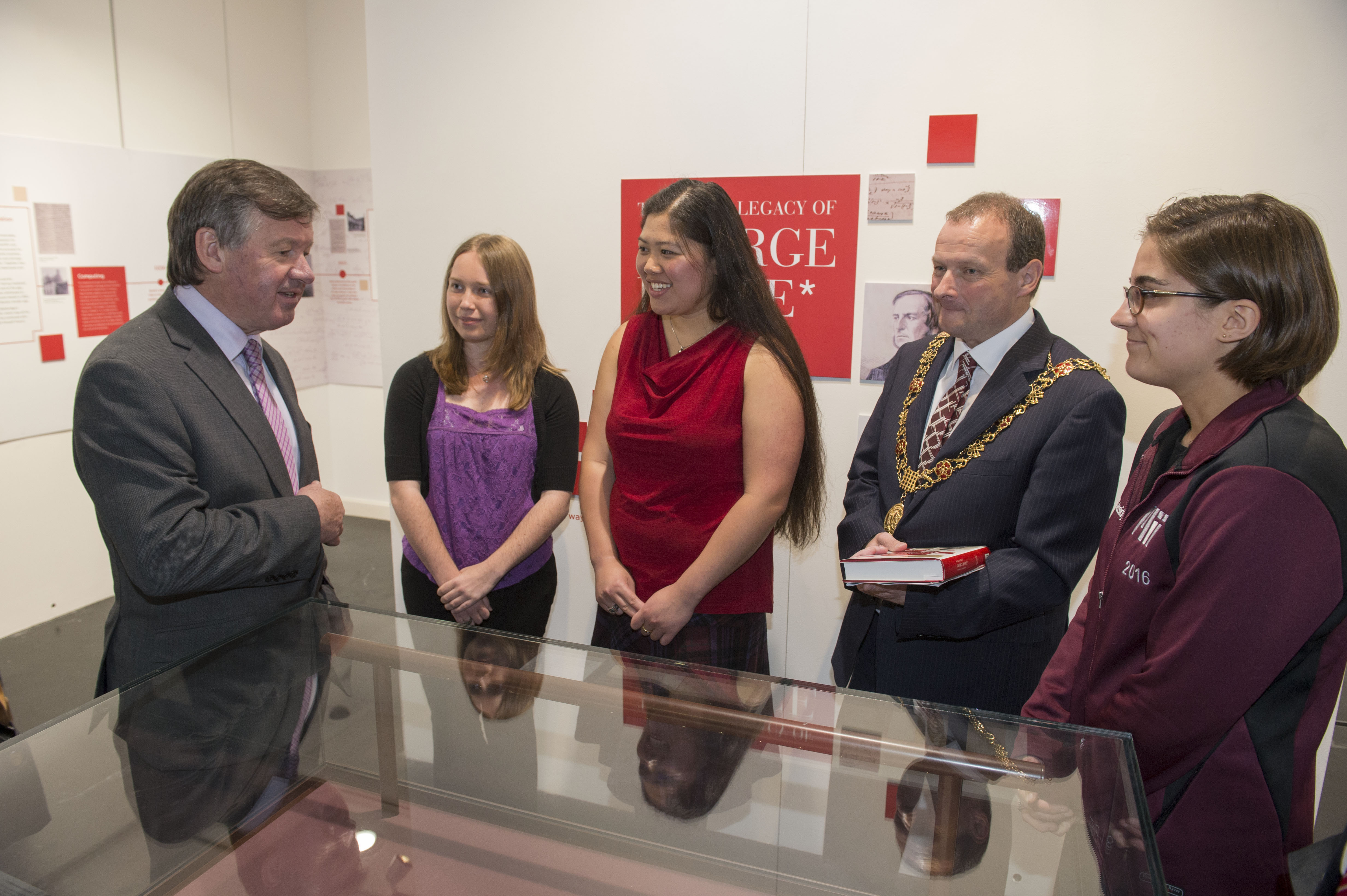President of UCC Dr. Michael Murphy and Lord Mayor of Cork City Chris O'Leary speaking with MIT students Laura Standley, Grace Cassidy and Emily Yue at the opening of UCC Library's exhibition, Life and Legacy of George Boole 1815 -2015.
